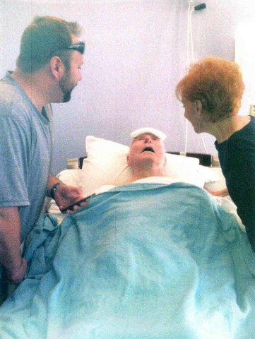 Robert Robinson, center, is shown in a hospital room after his injury. (Courtesy/Betty Robinson)