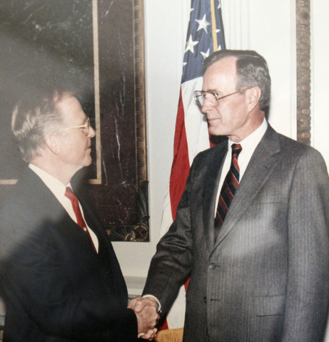 Robert Robinson shakes hands with then-Vice President George H.W. Bush in Washington, D.C. Robinson was the third optometrist in Las Vegas and served in the state Assembly for two terms and for on ...