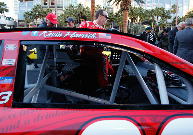 NASCAR Sprint Cup driver Kevin Harvick, who is No. 3 in the rankings, gets in his No. 29 car, at the Victory Lap event of the NASCAR Championship Week, outside of Planet Hollywood in Las Vegas on  ...