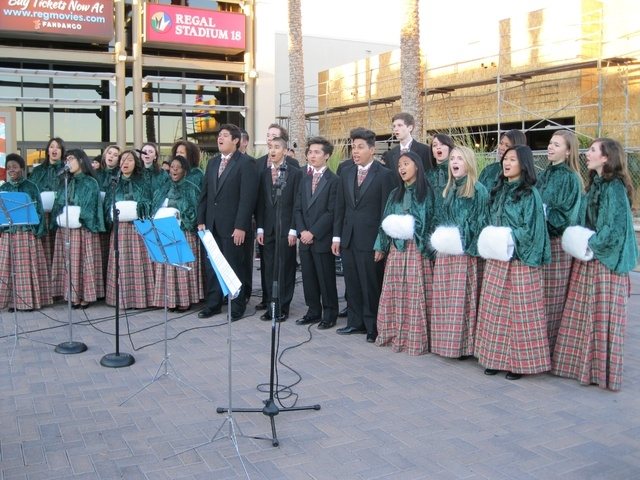 Students from Las Vegas Academy sing carols Nov. 30 at Village Square, 9400 W. Sahara Ave., as the shopping center heralded the holiday season with a Christmas tree-lighting ceremony. (Special to  ...