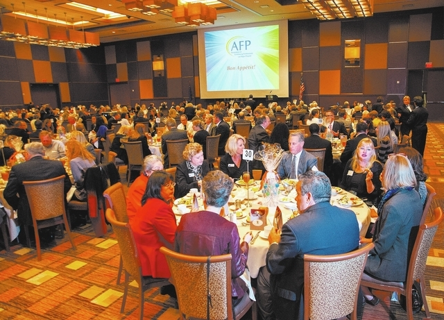 Guests enjoy lunch during the Association of Fundraising Professionals 22nd Annual National Philanthropy Day Awards Luncheon at the Golden Nugget hotel-casino in Las Vegas on Nov. 19, 2013. (Marti ...
