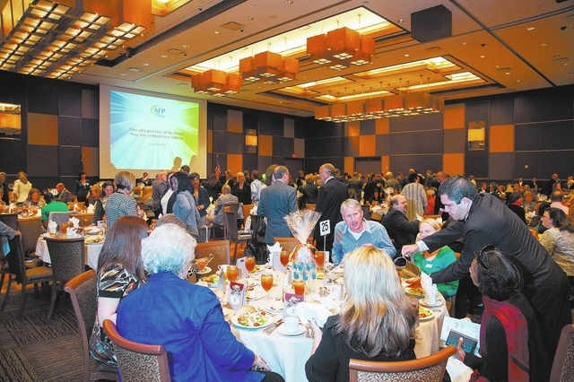 Guests mingle and enjoy lunch during the Association of Fundraising Professionals 22nd Annual National Philanthropy Day Awards Luncheon at the Golden Nugget hotel-casino in Las Vegas on Nov. 19, 2 ...