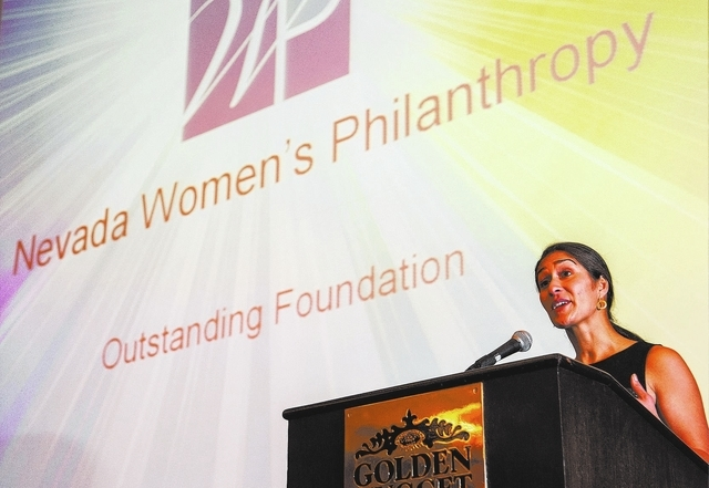 Naz Ford, President Nevada Women's Philanthropy speaks after receiving the award for Outstanding Foundation during the Association of Fundraising Professionals 22nd Annual National Philanthropy Da ...