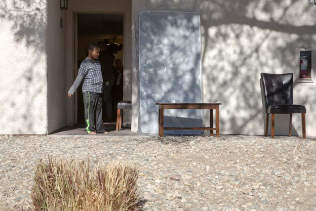 """Deandre Howard admires new furniture being delivered to his family's east Las Vegas apartment on Friday, Dec. 13, 2013. Every year Walker Furniture does a """"Home for the Holidays"""" charity ..."""