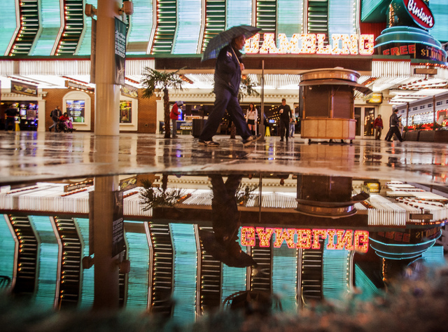 Free Wi-Fi is now available in a one-mile radius of the Fremont Street Experience. The service has been in testing and is now in operation. A man walks on Fremont Street in this Friday, Nov. 22, 2 ...