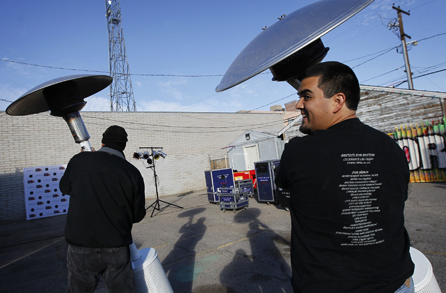 Anthony Tellez, right, and Richard Femenella move heaters into place in preparation for a cold First Friday event in Las Vegas on Dec. 6, 2013. (Jason Bean/Las Vegas Review-Journal)