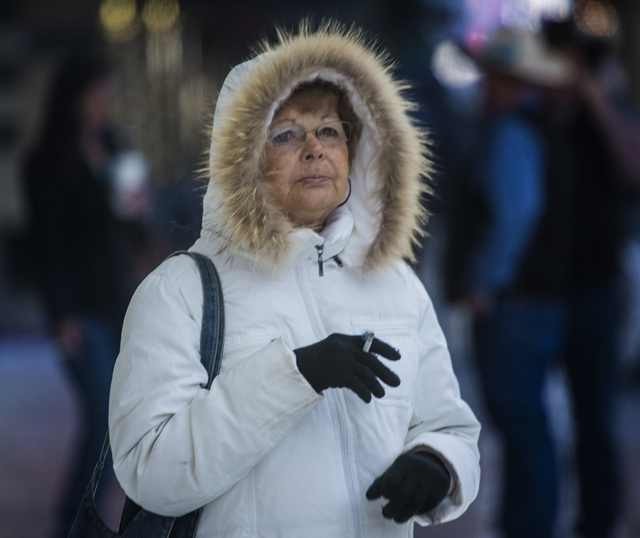 Judy Clem from McAllen, Texas, stands in front of Binion's Gambling Hall on Fremont Street, Monday, Dec. 9, 2013. She is in Las Vegas for the National Finals Rodeo. (Jeff Scheid/Las Vegas Review-J ...
