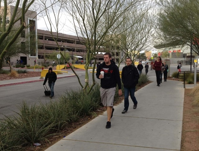Temperatures were below 40 degrees Wednesday morning, but many students were dressed just like UNLV student Charles Guertler, with a sweatshirt and shorts. (Greg Haas/Las Vegas Review-Journal)