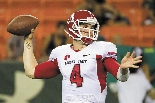 Fresno State quarterback Derek Carr has completed 70.1 percent of his passes for an average of 405.5 yards per game with 48 touchdowns and seven interceptions this season. (AP Photo/Eugene Tanner)
