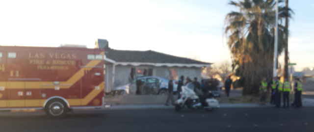 A vehicle slammed into a house in the 1700 block of South Eastern Avenue, near Eastern and Oakey Boulevard, Monday afternoon, Las Vegas police said. (Brett Steidler/Las Vegas Review-Journal)