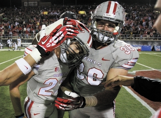 UNLV players congratulate Nolan Kohorst, left, after he scored the game winning field goal against Hawaii at Sam Boyd Stadium in Las Vegas Saturday, Oct. 12, 2013. (AP Photo/Las Vegas Review-Journ ...