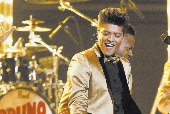 In demand performer Bruno Mars will hit the stage Sunday and Tuesday. (AP Photo/Matt Sayles)