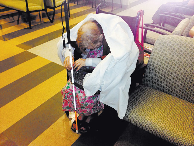 Sandi Niccum is shown slumped in a hospital waiting room on one of her last days. She was blind and in severe pain. She died Nov. 15 at a local hospice. (Courtesy Dee Redwine)