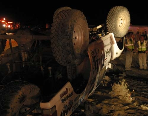 Emergency workers look at an off-highway vehicle that lost control and barreled into a crowd of spectators on Saturday, Aug. 14, 2010 at an off-road race in Lucerne Valley, Calif., killing eight p ...