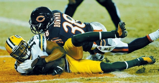 Green Bay Packers wide receiver Randall Cobb (18) dives into the end zone with the game-winning touchdown  reception against Chicago Bears cornerback Zack Bowman (38) during the second half of an  ...