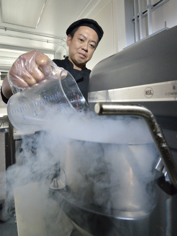 Joe Vergara adds liquid nitrogen to a pot while making Liquid Nitrogen Madagascar Vanilla ice cream at the ChillSpot in the Container Park at 707 Fremont St. in Las Vegas on Wednesday, Dec. 11, 20 ...