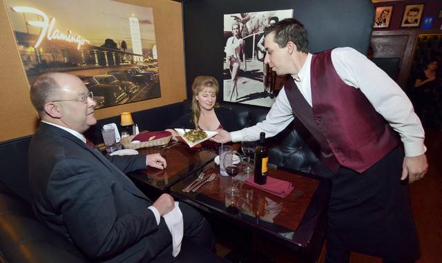 Waiter Bradley Gould, right, serves Mark Bush, left, and Susan Felkowski at Casa di Amore at 2850 E. Tropicana Ave. in Las Vegas on Saturday, Dec. 14, 2013. (Bill Hughes/Las Vegas Review-Journal)