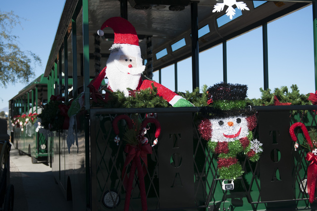 A Christmas decorated train on wheels is seen waiting for passengers to board at the Springs Preserve on Saturday. The Springs Preserve is offering activities for children during the holidays that ...