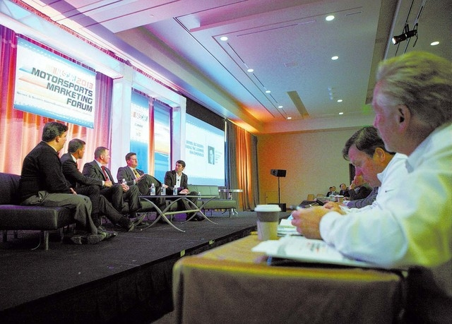 Steve O'Donnell, fourth from left, senior vice president of racing operations at NASCAR, speaks during a panel discussion at the Motorsport Marketing Forum at Aria hotel-casino Wednesday, Dec. 4,  ...