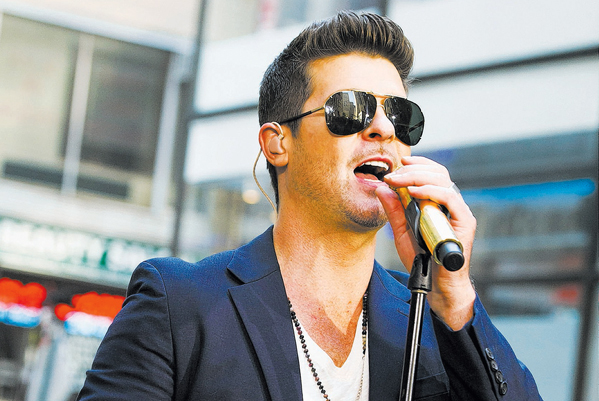 Robin Thicke performs Sunday at the Palms. (Photo by Charles Sykes/Invision/AP)