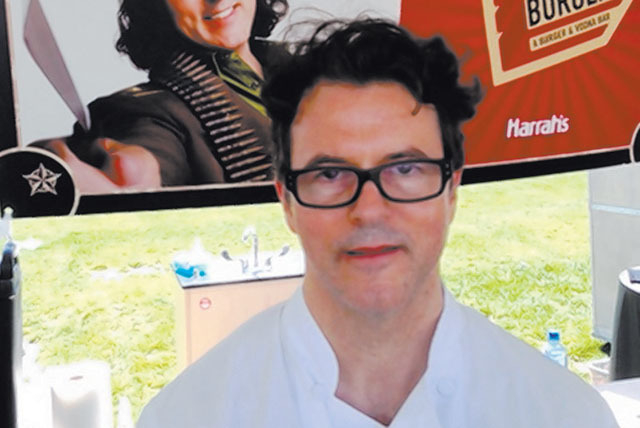Chef Kerry Simon, shown at a June event, was diagnosed last month with an aggressive form of Parkinson's disease. (Norm Clarke photo)