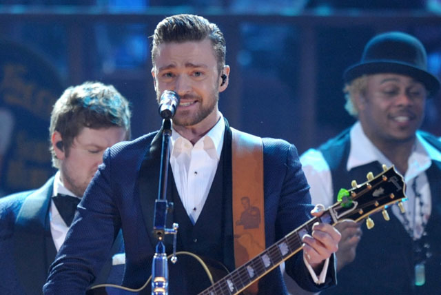 In this Nov. 24, 2013 file photo, Justin Timberlake performs on stage at the American Music Awards at the Nokia Theatre L.A. Live in Los Angeles. Timberlake was among the top nominees for the 56th ...