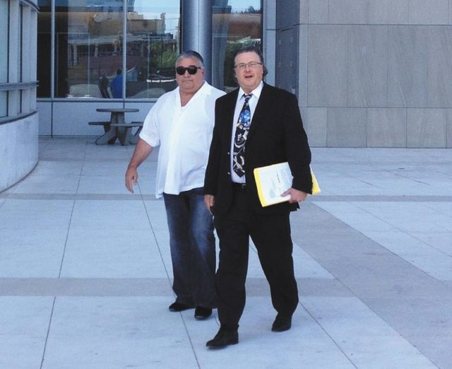 Reputed New York mob figure Vincent Faraci, left, walks into the federal courthouse in Las Vegas with his lawyer, David Chesnoff, to plead guilty to filing a false 2006 tax return, Wed., July 17,  ...