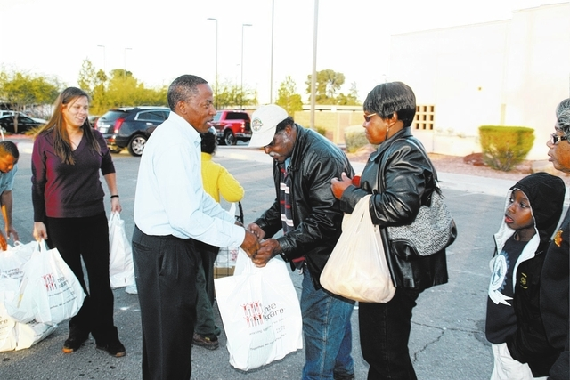 District D Clark County Commissioner Lawrence Weekly helps give out 400 Thanksgiving Day dinners to needy families on Nov. 26 at the Martin Luther King Community Resource Center, 2432 Martin Luthe ...