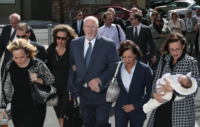 Surrounded by family and friends, Harvey Whittemore walks into federal court in Reno on Sept. 30. He was sentenced to two years in prison after he was convicted in May for unlawfully funneling cam ...