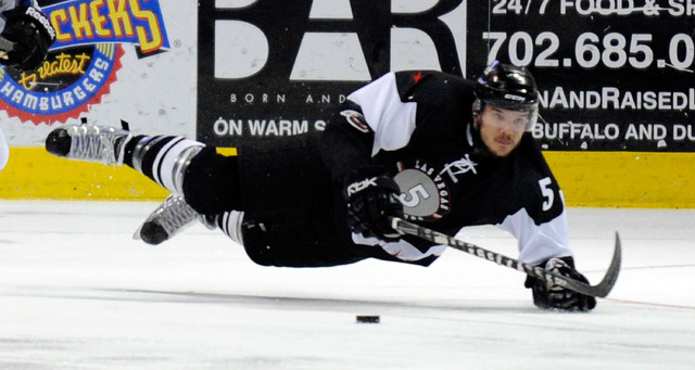 Las Vegas Wrangler Jeff May flies though the air as the puck passes by during first period action against the Idaho Steelheads at the Orleans Arena on Friday, March 23, 2012.  (David Becker/Las Ve ...