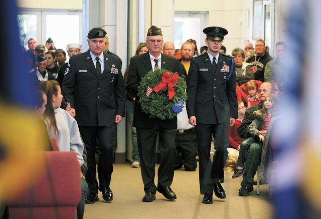 U.S. Air Force Senior Master Sgt. Scott Moody, left to right, Robert Garlow, state commander of VFW Post 36 in Boulder City, and Civil Air Patrol Cadet Bert Kirk participate in a Wreaths Across Am ...