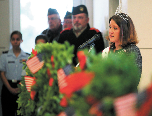 Mrs. Nevada Global Nations and U.S. Air Force veteran Pranava Moody (cq), far right, speaks during a Wreaths Across America ceremony at Veterans Memorial Cemetery Saturday, Dec. 14, 2013, in Bould ...