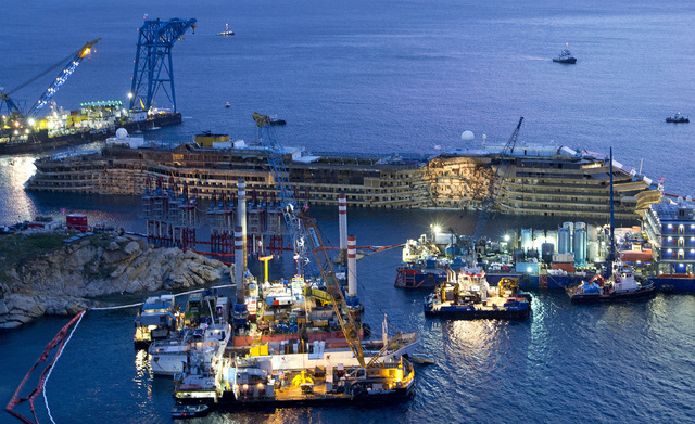 FOR USE AS DESIRED, YEAR END PHOTOS - FILE - The Costa Concordia is seen after it was lifted upright, on the Tuscan Island of Giglio, Italy, early Tuesday morning, Sept. 17, 2013. The crippled cru ...
