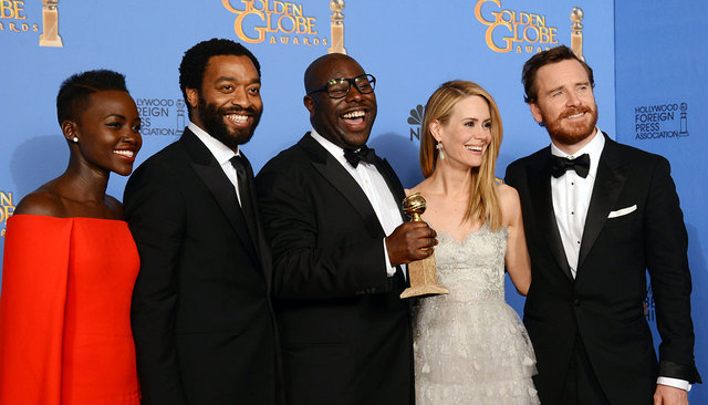 """From left, Lupita Nyong'o, Chiwetel Ejiofor, Steve McQueen, Sarah Paulson and Michael Fassbender pose in the press room with the award for best motion picture drama for """"12 Years a Slave"""" at the 7 ..."""
