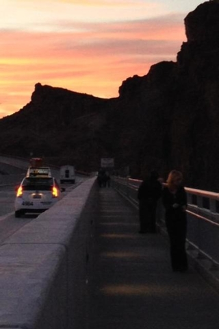 Francesca Bosco of Boulder City shot a photograph of a woman she believes might have jumped to her death off the Hoover Dam bypass bridge Friday night. Bosco was taking photographs of the sunset w ...