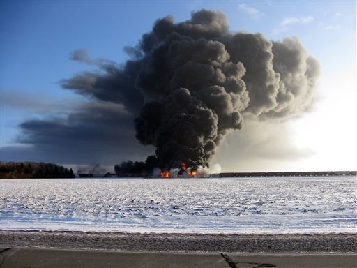 This photo provided by Cass County Commissioner Ken Pawluk shows a train derailment and fire west of Casselton, N.D., Monday, Dec. 30, 2013. No one has been reported hurt in the derailment or fire ...