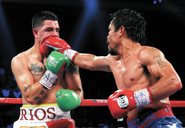 Manny Pacquiao, from the Philippines, right, lands a right to Brandon Rios of the United States during their WBO international welterweight title fight Sunday, Nov. 24, 2013, in Macau. Pacquiao de ...
