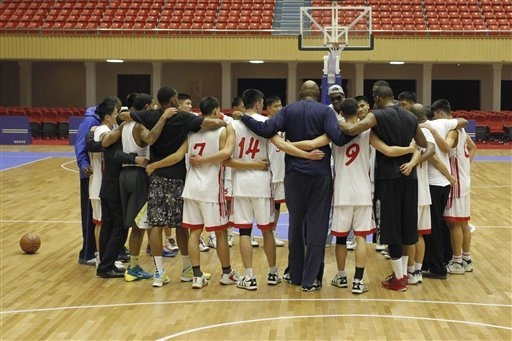 Dennis Rodman huddles with North Korean basketball players and fellow former NBA stars at a practice session in Pyongyang, North Korea on Tuesday, Jan. 7, 2014. Rodman came to the North Korean cap ...