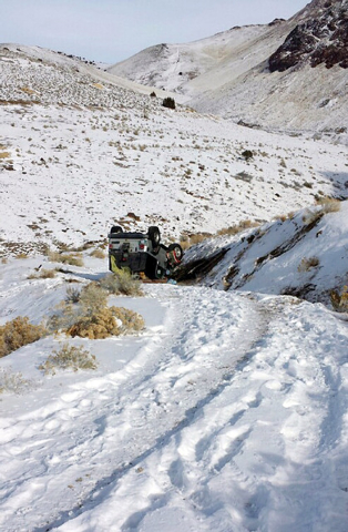 This Tuesday, Dec. 10, 2013 photo provided by searcher Lucia Gonzalez shows the vehicle belonging to a family who went missing after a trip to play in the snow near Lovelock, Nev. James Glanton, h ...