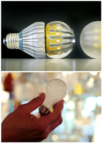 This combination of Associated Press file photos shows,  top, Switch75 light LED bulbs in clear and frosted, on Tuesday, Nov. 8, 2011 in New York and a 100-watt incandescent light bulb at Royal Li ...