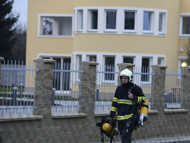 A fireman walks off the residence, back, of Palestinian ambassador to the Czech Republic Jamal Al Jamal, who was severely injured in an explosion in a diplomatic flat in Prague-Suchdol and was tak ...