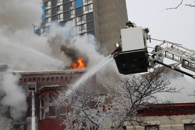 Crews battle a Minneapolis apartment fire on Wednesday, Jan. 1, 2014. The billowing fire engulfed a three-story building, sending 13 people to hospitals with injuries ranging from burns to trauma  ...