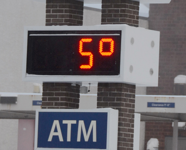 A bank thermometer reads in the single digits on Friday, Jan. 3, 2014, in Hazleton, Pa. Northern and eastern Pennsylvania saw 6 to 8 inches of snow, while southern and western Pennsylvania saw 2 t ...