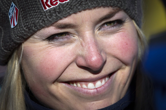 Lindsey Vonn smiles at the finish area following her training run at the women's World Cup downhill ski event in Lake Louise, Alberta, Canada, on Dec. 4, 2013. Vonn is going to skip the Sochi Olym ...