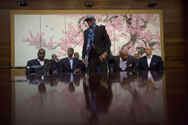 Dennis Rodman stands up to leave after he and fellow US basketball players completed a television interview at a Pyongyang, North Korea hotel Tuesday, Jan. 7, 2014. Rodman came to the North Korean ...