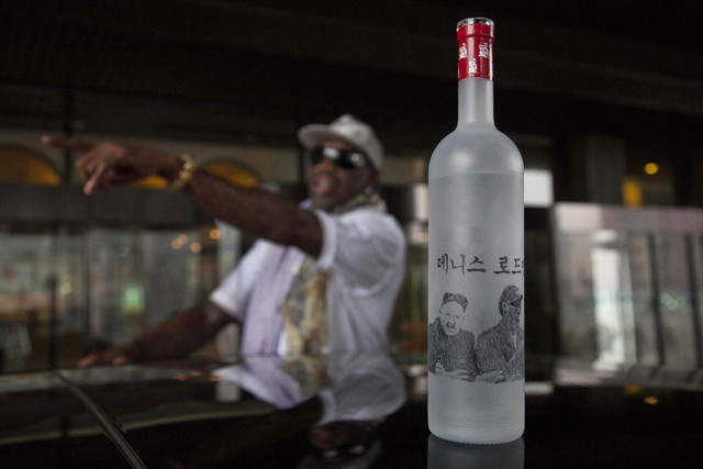 A bottle of vodka with handmade illustrations of Rodman with North Korean leader Kim Jong Un and Rodman's name in Korean sits on the roof of a car outside a Pyongyang hotel on Tuesday, Jan. 7, 201 ...