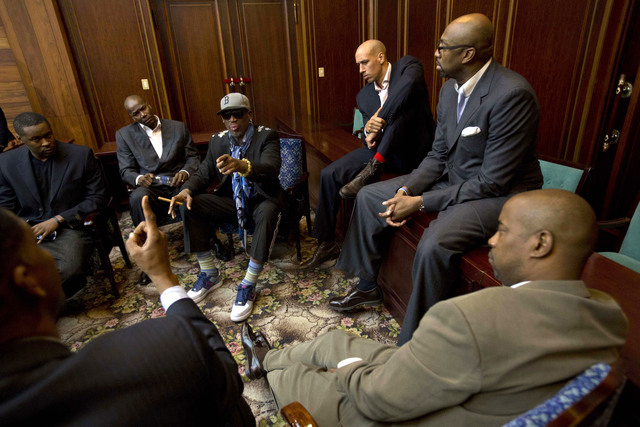 Dennis Rodman speaks with fellow US basketball players during a team meeting at a Pyongyang, North Korea hotel Tuesday, Jan. 7, 2014. Rodman came to the North Korean capital with a team of USA bas ...