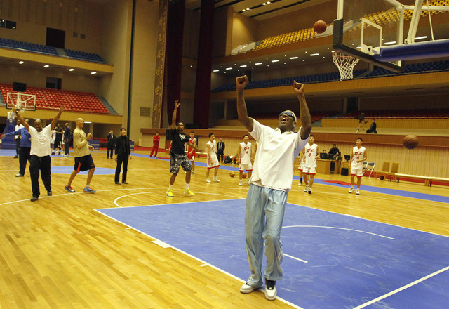 Dennis Rodman cheers after a fellow U.S. basketball player makes a jump shot during a practice session with North Korean players in Pyongyang, North Korea on Tuesday, Jan. 7, 2014. Rodman came to  ...