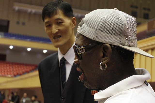 Dennis Rodman, right,  meets with former North Korean basketball player Ri Myung Hun at a practice session with USA and North Korean players in Pyongyang, North Korea on Tuesday, Jan. 7, 2014. Rod ...