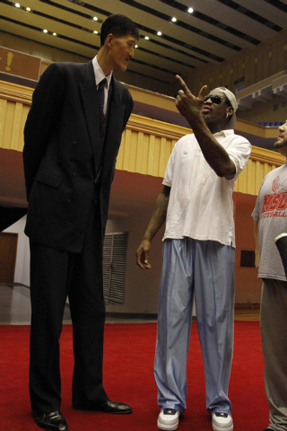 Dennis Rodman meets with former North Korean basketball player Ri Myung Hun, left,  at a practice session with USA and North Korean players in Pyongyang, North Korea on Tuesday, Jan. 7, 2014. Rodm ...
